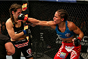 FORT CAMPBELL, KENTUCKY - NOVEMBER 6:  (R-L) Liz Carmouche punches Alexis Davis in their UFC women's bantamweight bout on November 6, 2013 in Fort Campbell, Kentucky. (Photo by Ed Mulholland/Zuffa LLC/Zuffa LLC via Getty Images) *** Local Caption ***Liz Carmouche; Alexis Davis
