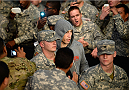 FORT CAMPBELL, KENTUCKY - NOVEMBER 6:  Tim Kennedy (center) walks to the Octagon to face Rafael Natal in their UFC middleweight bout on November 6, 2013 in Fort Campbell, Kentucky. (Photo by Jeff Bottari/Zuffa LLC/Zuffa LLC via Getty Images) *** Local Caption ***Tim Kennedy