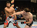 FORT CAMPBELL, KENTUCKY - NOVEMBER 6:  (R-L) Tim Kennedy punches Rafael Natal in their UFC middleweight bout on November 6, 2013 in Fort Campbell, Kentucky. (Photo by Jeff Bottari/Zuffa LLC/Zuffa LLC via Getty Images) *** Local Caption ***Tim Kennedy; Rafael Natal