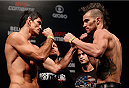 GOIANIA, BRAZIL - NOVEMBER 08:  (L-R) Opponents Paulo Thiago and Brandon Thatch face off during the UFC weigh-in event at Arena Goiania on November 8, 2013 in Goiania, Brazil. (Photo by Josh Hedges/Zuffa LLC/Zuffa LLC via Getty Images)