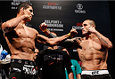 "GOIANIA, BRAZIL - NOVEMBER 08:  (L-R) Opponents Cezar ""Mutante"" Ferreira and Daniel Sarafian face off during the UFC weigh-in event at Arena Goiania on November 8, 2013 in Goiania, Brazil. (Photo by Josh Hedges/Zuffa LLC/Zuffa LLC via Getty Images)"