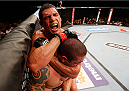 GOIANIA, BRAZIL - NOVEMBER 09: (L-R) Cezar ''Mutante'' Ferreira attempts a rear choke against Daniel Sarafian in their middleweight bout during the UFC event at Arena Goiania on November 9, 2013 in Goiania, Brazil. (Photo by Josh Hedges/Zuffa LLC/Zuffa LLC via Getty Images)