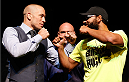 LAS VEGAS, NV - NOVEMBER 14: (L-R) Opponents Georges St-Pierre and Johny Hendricks face off during the final UFC 167 pre-fight press conference inside the Hollywood Theatre at the MGM Grand Hotel/Casino on November 14, 2013 in Las Vegas, Nevada. (Photo by Josh Hedges/Zuffa LLC/Zuffa LLC via Getty Images)