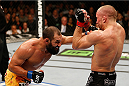 LAS VEGAS, NV - NOVEMBER 16:  (L-R) Johny Hendricks punches Georges St-Pierre in their UFC welterweight championship bout during the UFC 167 event inside the MGM Grand Garden Arena on November 16, 2013 in Las Vegas, Nevada. (Photo by Josh Hedges/Zuffa LLC/Zuffa LLC via Getty Images) *** Local Caption *** Georges St-Pierre; Johny Hendricks