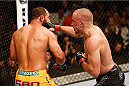 LAS VEGAS, NV - NOVEMBER 16:  (R-L) Georges St-Pierre punches Johny Hendricks in their UFC welterweight championship bout during the UFC 167 event inside the MGM Grand Garden Arena on November 16, 2013 in Las Vegas, Nevada. (Photo by Josh Hedges/Zuffa LLC/Zuffa LLC via Getty Images) *** Local Caption *** Georges St-Pierre; Johny Hendricks