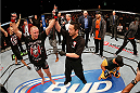 LAS VEGAS, NV - NOVEMBER 16:  Georges St-Pierre (left) reacts to his decision win over Johny Hendricks (right) in their UFC welterweight championship bout during the UFC 167 event inside the MGM Grand Garden Arena on November 16, 2013 in Las Vegas, Nevada. (Photo by Josh Hedges/Zuffa LLC/Zuffa LLC via Getty Images) *** Local Caption *** Georges St-Pierre; Johny Hendricks