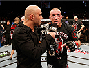 LAS VEGAS, NV - NOVEMBER 16:  Georges St-Pierre (right) is interviewed by Joe Rogan (left) during the UFC 167 event inside the MGM Grand Garden Arena on November 16, 2013 in Las Vegas, Nevada. (Photo by Josh Hedges/Zuffa LLC/Zuffa LLC via Getty Images) *** Local Caption *** Georges St-Pierre; Joe Rogan