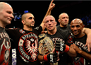LAS VEGAS, NV - NOVEMBER 16:  Georges St-Pierre (with belt) celebrates with his teammates after his victory over Johny Hendricks in their UFC welterweight championship bout during the UFC 167 event inside the MGM Grand Garden Arena on November 16, 2013 in Las Vegas, Nevada. (Photo by Donald Miralle/Zuffa LLC/Zuffa LLC via Getty Images) *** Local Caption *** Georges St-Pierre; Johny Hendricks