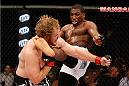LAS VEGAS, NV - NOVEMBER 30:  (R-L) Walt Harris kicks Jared Rosholt in their heavyweight fight during The Ultimate Fighter season 18 live finale inside the Mandalay Bay Events Center on November 30, 2013 in Las Vegas, Nevada. (Photo by Josh Hedges/Zuffa LLC/Zuffa LLC via Getty Images) *** Local Caption *** Jared Rosholt; Walt Harris