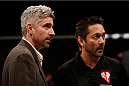 LAS VEGAS, NV - NOVEMBER 30:  (L-R) Executive Director of the Nevada State Athletic Commission Keith Kizer and referee Mario Yamasaki discuss the stoppage between Maximo Blanco and Akira Corassani in their featherweight fight during The Ultimate Fighter season 18 live finale inside the Mandalay Bay Events Center on November 30, 2013 in Las Vegas, Nevada. (Photo by Josh Hedges/Zuffa LLC/Zuffa LLC via Getty Images) *** Local Caption *** Keith Kizer; Mario Yamasaki