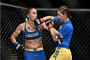 LAS VEGAS, NV - NOVEMBER 30:  (L-R) Raquel Pennington and Roxanne Modafferi exchange punches in their women's bantamweight fight during The Ultimate Fighter season 18 live finale inside the Mandalay Bay Events Center on November 30, 2013 in Las Vegas, Nevada. (Photo by Jeff Bottari/Zuffa LLC/Zuffa LLC via Getty Images) *** Local Caption *** Roxanne Modafferi; Raquel Pennington