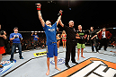 LAS VEGAS, NV - NOVEMBER 30:  Chris Holdsworth (L) celebrates after defeating David Grant in their bantamweight final fight during The Ultimate Fighter season 18 live finale inside the Mandalay Bay Events Center on November 30, 2013 in Las Vegas, Nevada. (Photo by Josh Hedges/Zuffa LLC/Zuffa LLC via Getty Images) *** Local Caption *** Chris Holdsworth; David Grant