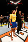 LAS VEGAS, NV - NOVEMBER 30:  Julianna Pena celebrates after defeating Jessica Rakoczy in their women's bantamweight final fight during The Ultimate Fighter season 18 live finale inside the Mandalay Bay Events Center on November 30, 2013 in Las Vegas, Nevada. (Photo by Josh Hedges/Zuffa LLC/Zuffa LLC via Getty Images) *** Local Caption *** Julianna Pena; Jessica Rakoczy