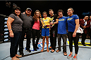 LAS VEGAS, NV - NOVEMBER 30:  Julianna Pena celebrates with her family and corner including Miesha Tate after defeating Jessica Rakoczy in their women's bantamweight final fight during The Ultimate Fighter season 18 live finale inside the Mandalay Bay Events Center on November 30, 2013 in Las Vegas, Nevada. (Photo by Josh Hedges/Zuffa LLC/Zuffa LLC via Getty Images) *** Local Caption *** Julianna Pena; Miesha Tate