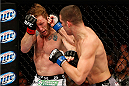 LAS VEGAS, NV - NOVEMBER 30:  (R-L) Nate Diaz punches Gray Maynard in their lightweight fight during The Ultimate Fighter season 18 live finale inside the Mandalay Bay Events Center on November 30, 2013 in Las Vegas, Nevada. (Photo by Josh Hedges/Zuffa LLC/Zuffa LLC via Getty Images) *** Local Caption *** Gray Maynard; Nate Diaz