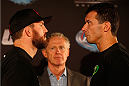 BRISBANE, AUSTRALIA - DECEMBER 05:  (L-R) Opponents Ryan Bader and Anthony Perosh face off during the UFC Ultimate Media Day at the Brisbane Marriott Hotel on December 5, 2013 in Brisbane, Australia. (Photo by Josh Hedges/Zuffa LLC/Zuffa LLC via Getty Images)