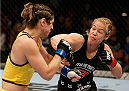 BRISBANE, AUSTRALIA - DECEMBER 07:  (R-L) Julie Kedzie punches Bethe Correia in their women's bantamweight fight during the UFC Fight Night event at the Brisbane Entertainment Centre on December 7, 2013 in Brisbane, Australia. (Photo by Josh Hedges/Zuffa LLC/Zuffa LLC via Getty Images)