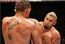 BRISBANE, AUSTRALIA - DECEMBER 07:  (R-L) Mark Hunt punches Antonio