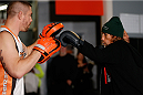 SACRAMENTO, CA - DECEMBER 11:  (R-L) Urijah Faber works out with head coach Duane Ludwig during an open training session for media at Ultimate Fitness on December 11, 2013 in Sacramento, California. (Photo by Josh Hedges/Zuffa LLC/Zuffa LLC via Getty Images)
