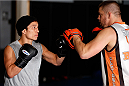 SACRAMENTO, CA - DECEMBER 11:  (L-R) Joseph Benavidez works out with head coach Duane Ludwig during an open training session for media at Ultimate Fitness on December 11, 2013 in Sacramento, California. (Photo by Josh Hedges/Zuffa LLC/Zuffa LLC via Getty Images)