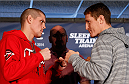 SACRAMENTO, CA - DECEMBER 12:  (R-L) Opponents Joe Lauzon and Mac Danzig face off during the final pre-fight press conference before the UFC on FOX event at Sleep Train Arena on December 12, 2013 in Sacramento, California. (Photo by Josh Hedges/Zuffa LLC/Zuffa LLC via Getty Images)