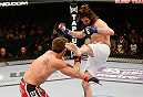 SACRAMENTO, CA - DECEMBER 14:  (R-L) Cody McKenzie kicks Sam Stout in their lightweight bout during the UFC on FOX event at Sleep Train Arena on December 14, 2013 in Sacramento, California. (Photo by Josh Hedges/Zuffa LLC/Zuffa LLC via Getty Images) *** Local Caption *** Sam Stout; Cody McKenzie