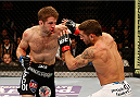 SACRAMENTO, CA - DECEMBER 14:  (L-R) Nik Lentz punches Chad Mendes in their featherweight bout during the UFC on FOX event at Sleep Train Arena on December 14, 2013 in Sacramento, California. (Photo by Josh Hedges/Zuffa LLC/Zuffa LLC via Getty Images) *** Local Caption *** Chad Mendes; Nik Lentz