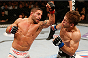 SACRAMENTO, CA - DECEMBER 14:  (L-R) Chad Mendes punches Nik Lentz in their featherweight bout during the UFC on FOX event at Sleep Train Arena on December 14, 2013 in Sacramento, California. (Photo by Josh Hedges/Zuffa LLC/Zuffa LLC via Getty Images) *** Local Caption *** Chad Mendes; Nik Lentz