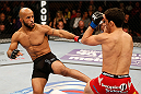 SACRAMENTO, CA - DECEMBER 14:  (L-R) Demetrious Johnson kicks Joseph Benavidez in their flyweight championship bout during the UFC on FOX event at Sleep Train Arena on December 14, 2013 in Sacramento, California. (Photo by Josh Hedges/Zuffa LLC/Zuffa LLC via Getty Images) *** Local Caption *** Demetrious Johnson; Joseph Benavidez