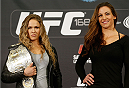 LAS VEGAS, NV - DECEMBER 26:  (L-R) Opponents Ronda Rousey and Miesha Tate pose for photos during the UFC 168 pre-fight press conference at the MGM Grand Hotel/Casino on December 26, 2013 in Las Vegas, Nevada. (Photo by Josh Hedges/Zuffa LLC/Zuffa LLC via Getty Images)