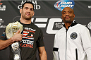 LAS VEGAS, NV - DECEMBER 26:  (L-R) Opponents Chris Weidman and Anderson Silva pose for photos during the UFC 168 pre-fight press conference at the MGM Grand Hotel/Casino on December 26, 2013 in Las Vegas, Nevada. (Photo by Josh Hedges/Zuffa LLC/Zuffa LLC via Getty Images)