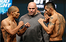 LAS VEGAS, NV - DECEMBER 27:  (L-R) Opponents Robbie Peralta and Estevan Payan face off during the UFC 168 weigh-in at the MGM Grand Garden Arena on December 27, 2013 in Las Vegas, Nevada. (Photo by Josh Hedges/Zuffa LLC/Zuffa LLC via Getty Images)