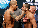 LAS VEGAS, NV - DECEMBER 27:  (L-R) Opponents Dustin Poirier and Diego Brandao face off during the UFC 168 weigh-in at the MGM Grand Garden Arena on December 27, 2013 in Las Vegas, Nevada. (Photo by Josh Hedges/Zuffa LLC/Zuffa LLC via Getty Images)
