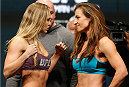 LAS VEGAS, NV - DECEMBER 27:  (L-R) Opponents Ronda Rousey and Miesha Tate face off during the UFC 168 weigh-in at the MGM Grand Garden Arena on December 27, 2013 in Las Vegas, Nevada. (Photo by Josh Hedges/Zuffa LLC/Zuffa LLC via Getty Images)