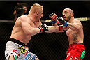 LAS VEGAS, NV - DECEMBER 28:  (L-R) Dennis Siver punches Manny Gamburyan in their featherweight bout during the UFC 168 event at the MGM Grand Garden Arena on December 28, 2013 in Las Vegas, Nevada. (Photo by Josh Hedges/Zuffa LLC/Zuffa LLC via Getty Images) *** Local Caption *** Dennis Siver; Manny Gamburyan