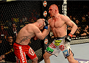 LAS VEGAS, NV - DECEMBER 28:  (R-L) Dennis Siver punches Manny Gamburyan in their featherweight bout during the UFC 168 event at the MGM Grand Garden Arena on December 28, 2013 in Las Vegas, Nevada. (Photo by Donald Miralle/Zuffa LLC/Zuffa LLC via Getty Images) *** Local Caption *** Dennis Siver; Manny Gamburyan