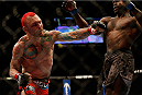 LAS VEGAS, NV - DECEMBER 28:  (L-R) Chris Leben punches Uriah Hall in their middleweight bout during the UFC 168 event at the MGM Grand Garden Arena on December 28, 2013 in Las Vegas, Nevada. (Photo by Josh Hedges/Zuffa LLC/Zuffa LLC via Getty Images) *** Local Caption *** Chris Leben; Uriah Hall