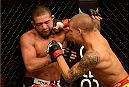 LAS VEGAS, NV - DECEMBER 28:  (R-L) Dustin Poirier punches Diego Brandao in their featherweight bout during the UFC 168 event at the MGM Grand Garden Arena on December 28, 2013 in Las Vegas, Nevada. (Photo by Donald Miralle/Zuffa LLC/Zuffa LLC via Getty Images) *** Local Caption *** Dustin Poirier; Diego Brandao