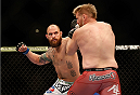 LAS VEGAS, NV - DECEMBER 28:  (L-R) Travis Browne punches Josh Barnett in their heavyweight bout during the UFC 168 event at the MGM Grand Garden Arena on December 28, 2013 in Las Vegas, Nevada. (Photo by Josh Hedges/Zuffa LLC/Zuffa LLC via Getty Images) *** Local Caption *** Josh Barnett; Travis Browne