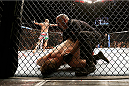 LAS VEGAS, NV - DECEMBER 28:  Travis Browne (rear) reacts to his victory over Josh Barnett in their heavyweight bout during the UFC 168 event at the MGM Grand Garden Arena on December 28, 2013 in Las Vegas, Nevada. (Photo by Josh Hedges/Zuffa LLC/Zuffa LLC via Getty Images) *** Local Caption *** Josh Barnett; Travis Browne