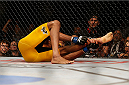 LAS VEGAS, NV - DECEMBER 28:  Anderson Silva holds his ankle during his UFC middleweight championship bout during the UFC 168 event at the MGM Grand Garden Arena on December 28, 2013 in Las Vegas, Nevada. (Photo by Josh Hedges/Zuffa LLC/Zuffa LLC via Getty Images) *** Local Caption *** Anderson Silva