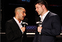 SINGAPORE - JANUARY 04:  (L to R) Announcers Jon Anik and  Brian Stann talk during the UFC Fight Night event at the Marina Bay Sands Resort on January 4, 2014 in Singapore. (Photo by Mitch Viquez/Zuffa LLC/Zuffa LLC via Getty Images)