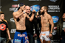 DULUTH, GEORGIA - JANUARY 14:  (L-R) Cole Miller and Sam Sicilia face off during the UFC Fight Night weigh-in event at the Arena at Gwinnett Center on January 14, 2014 in Duluth, Georgia. (Photo by Jeff Bottari/Zuffa LLC/Zuffa LLC via Getty Images)