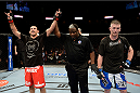 DULUTH, GA - JANUARY 15: (L-R) Vinc Pichel reacts after winning by decision against Garett Whiteley in their lightweight fight during the UFC Fight Night event inside The Arena at Gwinnett Center on January 15, 2014 in Duluth, Georgia. (Photo by Jeff Bottari/Zuffa LLC/Zuffa LLC via Getty Images)