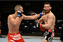 DULUTH, GA - JANUARY 15: (L-R) Louis Smolka punches Alpetkin Ozkilic in their featherweight fight during the UFC Fight Night event inside The Arena at Gwinnett Center on January 15, 2014 in Duluth, Georgia. (Photo by Jeff Bottari/Zuffa LLC/Zuffa LLC via Getty Images)