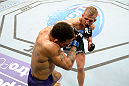 DULUTH, GA - JANUARY 15: (R-L) TJ Dillashaw battles Mike Easton in their bantamweight fight during the UFC Fight Night event inside The Arena at Gwinnett Center on January 15, 2014 in Duluth, Georgia. (Photo by Jeff Bottari/Zuffa LLC/Zuffa LLC via Getty Images)