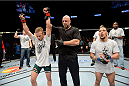 DULUTH, GA - JANUARY 15: (L-R) TJ Dillashaw reacts after winning by decision over Mike Easton in their bantamweight fight during the UFC Fight Night event inside The Arena at Gwinnett Center on January 15, 2014 in Duluth, Georgia. (Photo by Jeff Bottari/Zuffa LLC/Zuffa LLC via Getty Images)