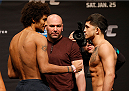 CHICAGO, IL - JANUARY 24:  (L-R) Opponents Alex Caceres and Sergio Pettis face off during the UFC weigh-in event at the Chicago Theatre on January 24, 2014 in Chicago, Illinois. (Photo by Josh Hedges/Zuffa LLC/Zuffa LLC via Getty Images)