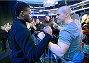 NEWARK, NJ - JANUARY 31:  (L-R) UFC Light Heavyweight Champion Jon 'Bones' Jones squares off with UFC fan Sean Cussick of Newark, NJ before the UFC 169 weigh-in event at the Prudential Center on January 31, 2014 in Newark, New Jersey. (Photo by Jeff Bottari/Zuffa LLC/Zuffa LLC via Getty Images)