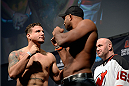 NEWARK, NJ - JANUARY 31:  (L-R) Frank Mir and Alistair Overeem face off on stage during the UFC 169 weigh-in event at the Prudential Center on January 31, 2014 in Newark, New Jersey. (Photo by Jeff Bottari/Zuffa LLC/Zuffa LLC via Getty Images)